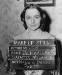 Olivia de Havilland as Melanie Wilkes.