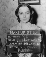 Olivia de Havilland as Melanie Wilkes.