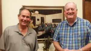 Author W. Thomas McQueeny (right) with Rob Rains in front of a portrait in The Citadel private office of the president.